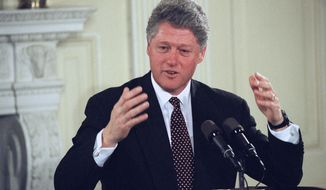 "President Bill Clinton, speaking to business leaders at the White House in Washington, Jan. 17, 1994, predicted a ""difficult few weeks"" for the people of Los Angeles and Southern California. The president promised federal disaster aid for the state. (AP Photo/Wilfredo Lee)"