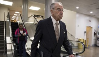 Senate Judiciary Committee Chairman Chuck Grassley, R-Iowa, walks through a basement passageway at the Capitol amid debates in the Senate on immigration, in Washington, Wednesday, Feb. 14, 2018. (AP Photo/J. Scott Applewhite) ** FILE **