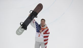 Shaun White, of the United States, celebrates winning the gold medal in the men's halfpipe finals at Phoenix Snow Park at the 2018 Winter Olympics in Pyeongchang, South Korea, Wednesday, Feb. 14, 2018. (AP Photo/Gregory Bull)