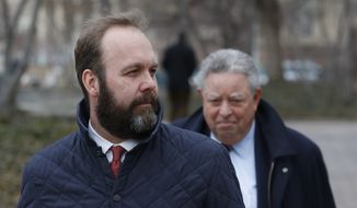 Rick Gates, left, with his lawyer Tom Green, depart federal district court in Washington on Wednesday, Feb. 14, 2018. (Associated Press) **FILE**