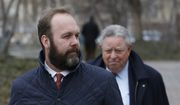 Rick Gates, left, with his lawyer Tom Green, depart Federal District Court, Wednesday, Feb. 14, 2018, in Washington. Paul Manafort, the former campaign chairman for President Donald Trump, and his business associate Rick Gates were in federal court on Wednesday for a routine status conference. Both were indicted in October on charges stemming from foreign lobbying work in Ukraine.  (AP Photo/Alex Brandon)