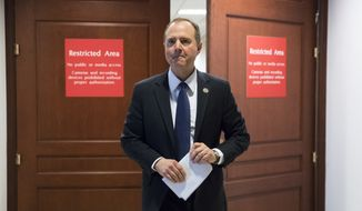 FILE - In this Feb. 5, 2018, file photo, Rep. Adam Schiff, D-Calif., ranking member of the House Permanent Select Committee on Intelligence, leaves a secure area where the panel meets at the Capitol in Washington. Schiff said Feb. 14, that he is continuing to negotiate with the FBI over the release of a memo packed with classified information from secret surveillance applications, but remains unsure if the White House will attempt to block its release.(AP Photo/J. Scott Applewhite, File)