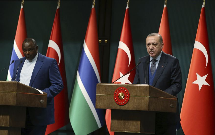 Turkey's President Recep Tayyip Erdogan, right, and Gambia's President Adama Barrow speak during a joint press conference at the presidential palace in Ankara, Turkey, Wednesday, Feb. 14, 2018. Barrow is in Turkey for a two-day state visit.(Kayhan Ozer/Pool Photo via AP)
