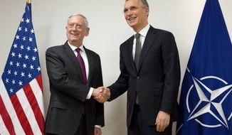 NATO Secretary General Jens Stoltenberg, right, shakes hands with U.S. Secretary for Defense Jim Mattis prior to a meeting at NATO headquarters in Brussels on Wednesday, Feb. 14, 2018. NATO defense ministers begin a two-day meeting Wednesday to focus on military spending, cooperation with the European Union, and assistance to the Iraqi army. (AP Photo/Virginia Mayo, Pool)