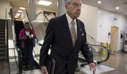 Senate Judiciary Committee Chairman Chuck Grassley, R-Iowa, walks through a basement passageway at the Capitol amid debates in the Senate on immigration, in Washington, Wednesday, Feb. 14, 2018. (AP Photo/J. Scott Applewhite)