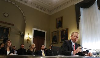 Budget Director Mick Mulvaney makes a note while attending a House Budget Committee hearing, Wednesday, Feb. 14, 2018, on Capitol Hill in Washington, after attending Ash Wednesday services. (AP Photo/Jacquelyn Martin)
