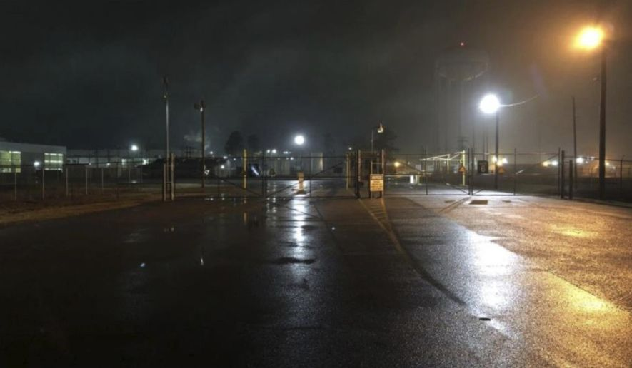 This image provided by KATV shows the exterior of a cosmetics factory near Little Rock, Ark., on Wednesday, Feb. 14, 2018.  Authorities say two people are dead after a shooting that was reported outside  the factory.  North Little Rock Police Sgt. Amy Cooper says officers found two people dead after responding to call about gunshots at about 3 a.m. Wednesday.  (KATV via AP