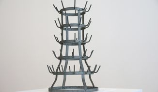 "In this Monday, Feb. 12, 2018 photo, ""Bottle Rack"", by conceptual artist Marcel Duchamp, is displayed at the Art Institute of Chicago in Chicago. Art Institute President and Eloise W. Martin Director James Rondeau says the piece ""is among the most pivotal, landmark works in Marcel Duchamp's profoundly influential body of work."" (Nancy Stone/Chicago Tribune via AP)"