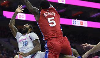 Miami Heat's James Johnson (16) takes a shot as Philadelphia 76ers' Amir Johnson (5) defends in the first half of an NBA basketball game, Wednesday, Feb. 14, 2018, in Philadelphia. (AP Photo/Michael Perez)