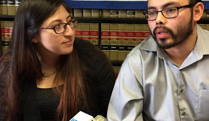 Lilian Calderon, left, and her husband, Luis Gordillo, speak at the office of the American Civil Liberties Union in Providence, R.I., on Wednesday, Feb. 14, 2018.  Immigration and Customs Enforcement released 30-year-old Lilian Calderon on Tuesday after officials granted a stay of deportation while she seeks legal status. A federal judge barred her deportation last week after the American Civil Liberties Union Foundation of Massachusetts filed suit.  (AP Photo/Michelle R. Smith)