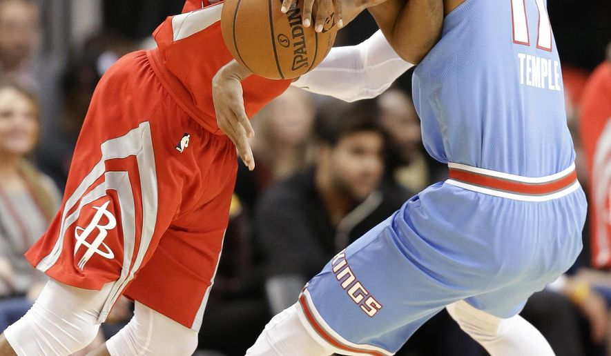 Houston Rockets guard Chris Paul, left, is fouled by Sacramento Kings guard Garrett Temple during the first half of an NBA basketball game Wednesday, Feb. 14, 2018, in Houston. (AP Photo/Eric Christian Smith)