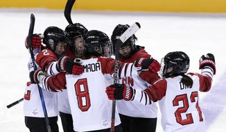 Shiori Koike (2), of Japan, celebrates with her teammates after scoring a goal against the combined Koreas during the third period of the preliminary round of the women's hockey game at the 2018 Winter Olympics in Gangneung, South Korea, Wednesday, Feb. 14, 2018. (AP Photo/Frank Franklin II)