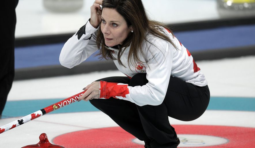 Canadian curler Cheryl Bernard arranges her hair during training sessions for the women's curling matches at the 2018 Winter Olympics in Gangneung, South Korea, Monday, Feb. 12, 2018. Bernard, 51, is the oldest athlete competing at the Pyeongchang olympics. (AP Photo/Aaron Favila)