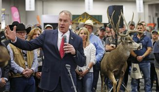 FILE--In this Feb. 9, 2018, file photo,U.S. Interior Secretary Ryan Zinke speaks during an conservation announcement at the Western Conservation and Hunting Expo Friday in Salt Lake City. On Monday, Feb. 12, 2018, the Interior Department released budget documents showing Zinke plans to press ahead with a massive overhaul of his department, including a plan to relocate some officials from Washington to the West and creating a new organizational map that mostly ignores state boundaries. (AP Photo/Rick Bowmer, file)