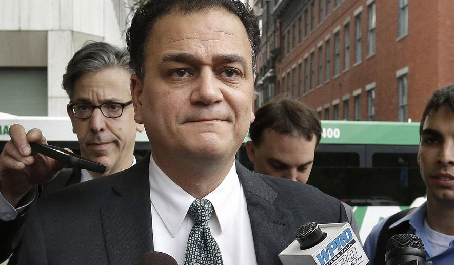FILE - In this June 11, 2015 file photo, former Rhode Island House Speaker GordonFox arrives at federal court in Providence, R.I. Fox completed the home confinement portion of his sentence Wednesday morning, Feb. 14, 2018, for a 2015 corruption conviction. (AP Photo/Steven Senne, File)