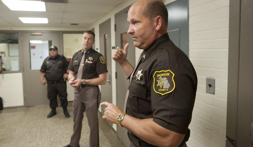 In this April 18, 2017 photo ,Jackson County Sheriff Steven Rand shows the current visiting area at the Jackson County Jail's Wesley Street in Jackson, Mich. Jackson County Lt. Tommy Schuette's filed a federal lawsuit against the county and Sheriff Steven Rand on Monday, Feb. 12, 2018. The lawsuit alleges Rand created a hostile work environment and harassed Schuette because of his disability. It also alleges the county didn't take action when Schuette reported Rand's behavior and aren't giving him proper disability coverage. (J. Scott Park/Jackson Citizen Patriot via AP)