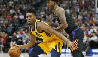 Phoenix Suns guard Elfrid Payton, right, guards Utah Jazz guard Donovan Mitchell, left, in the first half during an NBA basketball game Wednesday, Feb. 14, 2018, in Salt Lake City. (AP Photo/Rick Bowmer)