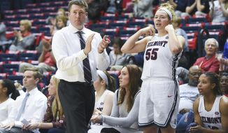 In this Nov. 15, 2017, photo provided by Belmont University, Belmont women's basketball coach Bart Brooks watches his team in an NCAA basketball game against Fort Wayne in Nashville, Tenn. Forward Maddie Wright (55) is at right. Belmont is in the AP Top 25 for the first time in school history. The Bruins (24-3) entered The Associated Press women's basketball poll Monday, Feb. 12, 2018, at No. 24.(Sam Simpkins/Belmont University via AP)