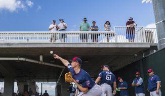 Minnesota Twins pitcher Aaron Slegers throws during spring baseball practice, Wednesday, Feb. 14, 2018 in Fort Meyers, Fla. (Mark Vancleave /Star Tribune via AP)