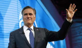 FILE - In this Jan. 19, 2018,, file photo, former Republican presidential candidate Mitt Romney waves after speaking about the tech sector during an industry conference, in Salt Lake City. Romney plans to announce Utah Senate campaign Thursday, Feb. 15, 2018. Three people with direct knowledge of the plan say Romney will formally launch his campaign in a video. (AP Photo/Rick Bowmer, File)