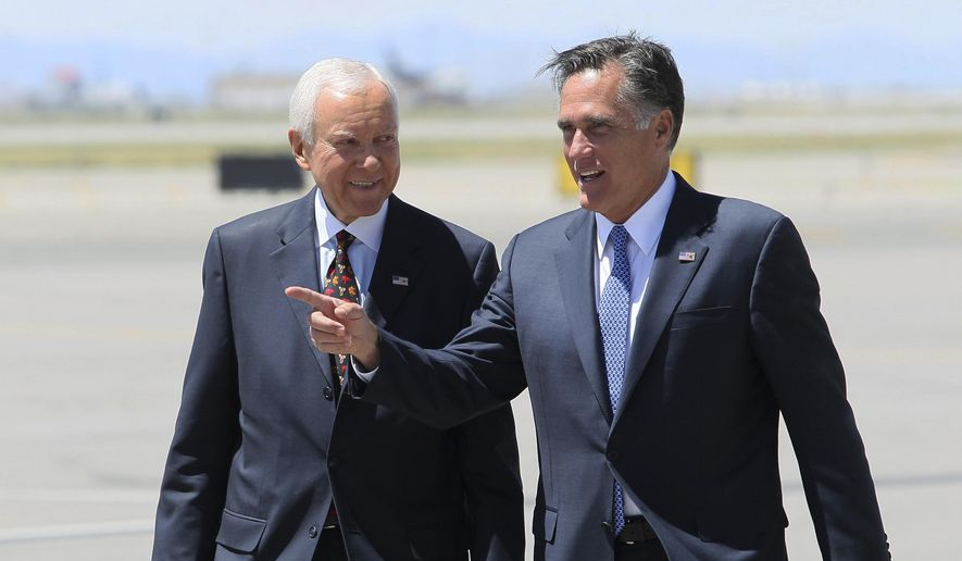 In this June 8, 2012, file photo, Republican presidential candidate and former Massachusetts Gov. Mitt Romney, left, walks alongside U.S. Senator Orrin Hatch, R-Utah, on the tarmac of Salt Lake City International Airport, in Salt Lake City. (AP Photo/Colin E. Braley, File)