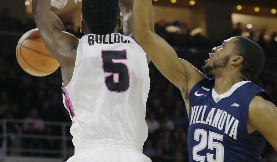 Providence forward Rodney Bullock (5) dunks against Villanova guard Mikal Bridges (25) during the first half of an NCAA college basketball game Wednesday, Feb. 14, 2018, in Providence, R.I. (AP Photo/Stephan Savoia)