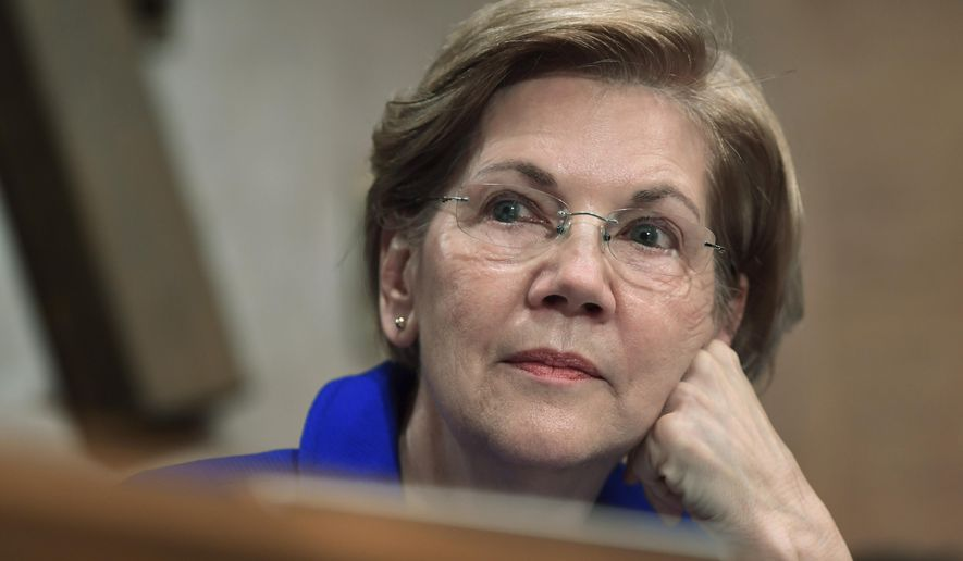 """FILE- In this Dec. 5, 2017, file photo, Sen. Elizabeth Warren, D-Mass., waits to speak during a meeting of the Senate Banking Committee on Capitol Hill in Washington. Warren said Wednesday that President Donald Trump is disrespecting Native Americans by referring to her as """"Pocahontas,"""" and she says that while she's not enrolled in any tribe, """"I never used my family tree to get a break or ... advance my career.""""  (AP Photo/Susan Walsh, File)"""