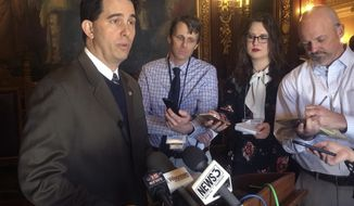 """Wisconsin Gov. Scott Walker, speaking to reporters, expresses confidence that his top priorities, including an overhaul of the juvenile justice system, will pass this session but he's not as enthusiastic about creating a new """"alcohol czar,"""" Wednesday, Feb. 14, 2018, in Madison, Wisc. (AP Photo/Scott Bauer)"""