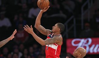 Washington Wizards guard Bradley Beal (3) shoots as New York Knicks guard Jarrett Jack (55) in the second half of an NBA basketball game in New York, Wednesday, Feb. 14, 2018. The Wizards defeated the Knicks 118-113. (AP Photo/Kathy Willens)