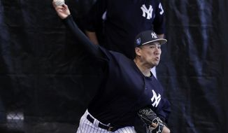 New York Yankees starting pitcher Masahiro Tanaka, of Japan, throws in the bullpen at baseball spring training camp, Wednesday, Feb. 14, 2018, in Tampa, Fla. (AP Photo/Lynne Sladky)