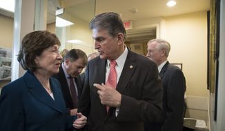 "Sen. Susan Collins, R-Maine, left, and Sen. Joe Manchin, D-W.Va., confer just before a news conference on the bipartisan immigration deal they reached with other centrists this week that sought to offer citizenship to young ""Dreamer"" immigrants and President Donald Trump's demands for billions to build a border wall with Mexico, at the Capitol in Washington, Thursday, Feb. 15, 2018. The Trump administration is already denouncing their deal in the Senate, saying it will ""create a mass amnesty for over 10 million illegal aliens, including criminals."" (AP Photo/J. Scott Applewhite)"