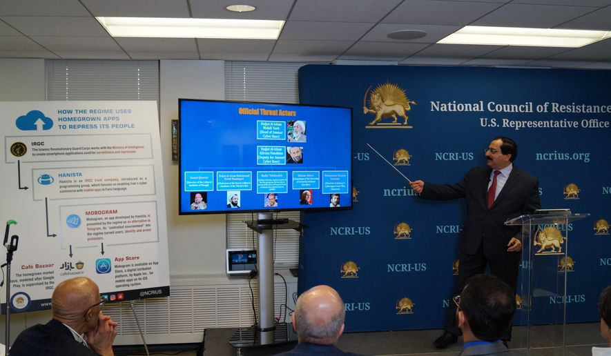 "Alireza Jafarzadeh, Deputy Director of the Washington office of the dissident National Council of Resistance of Iran (NCRI), speaking to reporters at a Feb. 15, 2018 news conference on ""cyberwarfare"" being waged by Iran's government. (Photo courtesy of NCRI)"
