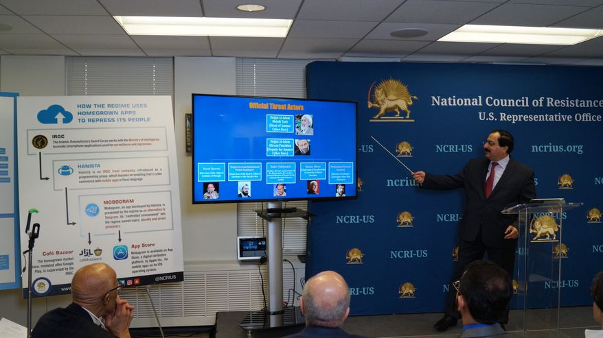 """Alireza Jafarzadeh, Deputy Director of the Washington office of the dissident National Council of Resistance of Iran (NCRI), speaking to reporters at a Feb. 15, 2018 news conference on """"cyberwarfare"""" being waged by Iran's government. (Photo courtesy of NCRI)"""