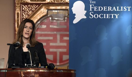 Associate Attorney General Rachel Brand addresses The Federalist Society luncheon in Washington, Thursday, Feb. 15, 2018. Brand, the third-highest-ranking official at the Justice Department, will step down nine months after she was confirmed as associate attorney general. (AP Photo/Susan Walsh)