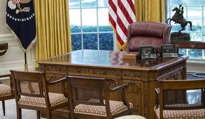 The Resolute Desk is seen in the newly refreshed Oval Office of the White House in Washington, Tuesday, Aug. 22, 2017, during a media tour. During an update of the West Wing, the Oval Office got new wallpaper and the floors were refinished. The draperies and furnishings are all part of the White House collection and were used by previous presidents. (AP Photo/Carolyn Kaster)