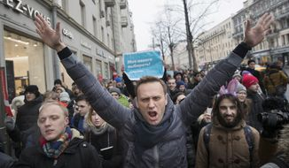In this file photo taken on Sunday, Jan. 28, 2018, Russian opposition leader Alexei Navalny, center, attends a rally in Moscow, Russia. Russia's communication providers have blocked access to the website of opposition leader Alexei Navalny on orders of the state communications watchdog. The agency, Roskomnadzor, demanded that Navalny remove a video alleging that Deputy Prime Minister Sergei Prikhodko received lavish hospitality from billionaire Oleg Deripaska following a court order or face his web resources being shut. (AP Photo/Evgeny Feldman, File)