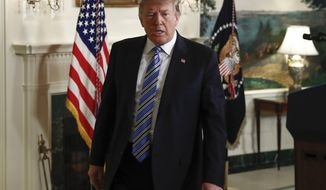 President Donald Trump walks from the Diplomatic Room of the White House, in Washington, Thursday, Feb 15, 2018, after speaking about the tragic shooting in Parkland, Fla. (AP Photo/Carolyn Kaster)