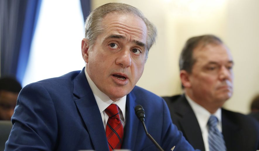 Veterans Affairs Secretary David Shulkin, left, next to James Manker, VA Acting Principal Deputy Under Secretary for Benefits, speaks about FY19 to the House Veterans Affairs Committee, Thursday, Feb. 15, 2018, on Capitol Hill in Washington. (AP Photo/Jacquelyn Martin) **FILE**