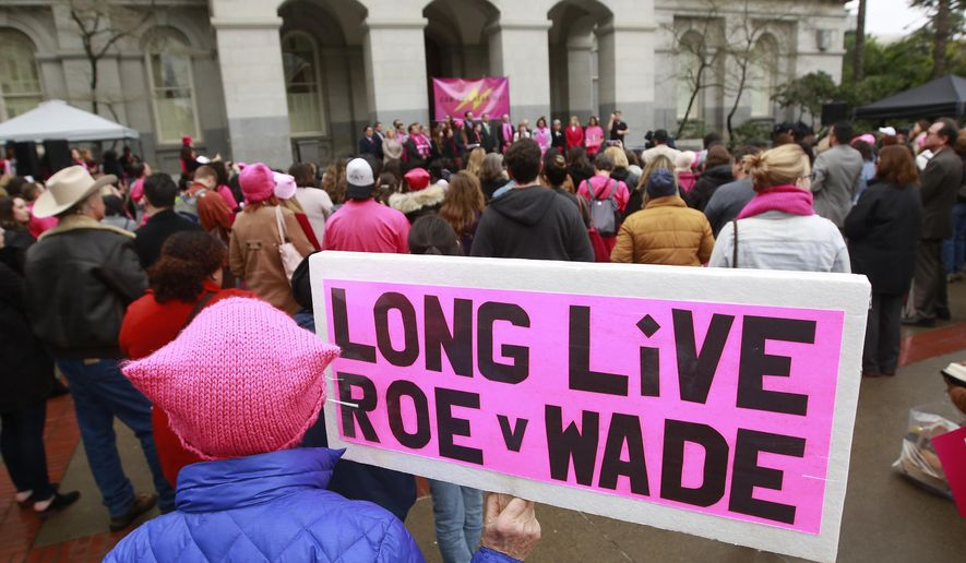 """In this Jan. 22, 2018 file photo, supporters attend a rally held by Planned Parenthood, commemorating the 45th anniversary of the landmark Roe vs. Wade Supreme Court ruling at the Capitol in Sacramento, Calif.  A consortium of five colleges in Massachusetts has designed a """"reproductive justice"""" certificate that aims to """"help educate the next generation of reproductive health scholars, practitioners and advocates."""" (AP Photo/Rich Pedroncelli) **FILE**"""