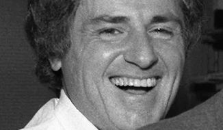 """FILE - This Dec. 13, 1985 file photo shows TV sportscaster Warner Wolf. Warner Wolf, the sportscaster who popularized the phrase """"Let's go to the videotape,"""" sued radio shock jock Don Imus for age discrimination on Thursday, Feb. 15, 2018. The lawsuit filed by the now 80-year-old charges that Imus and officials at WABC illegally fired Wolf in October 2016 and replaced him with a much younger sportscaster. (AP Photo/File)"""