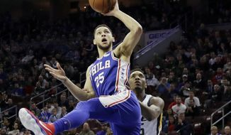 FILE - In this Nov. 20, 2017, file photo, Philadelphia 76ers' Ben Simmons, left, goes up for a shot against Utah Jazz's Donovan Mitchell, right, during the first half of an NBA basketball game in Philadelphia. Simmons and Mitchell, the leading rookie of the year candidates, will play together Friday night, Feb. 16, 2018, when the NBA's best first- and second-year players compete in the Rising Stars game in Los Angeles to tip off All-Star weekend. (AP Photo/Matt Slocum, File) **FILE**