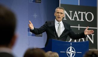 NATO Secretary General Jens Stoltenberg speaks during a media conference after a meeting of NATO defense ministers meeting at NATO headquarters in Brussels on Thursday, Feb. 15, 2018. (AP Photo/Virginia Mayo)