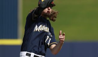 Milwaukee Brewers relief pitcher Josh Hader catches a popup during a drill at the team's spring training baseball facility Thursday, Feb. 15, 2018, in Maryvale, Ariz. (AP Photo/Carlos Osorio)
