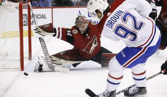 Arizona Coyotes goaltender Antti Raanta (32) makes a save on a shot by Montreal Canadiens center Jonathan Drouin (92) during the second period of an NHL hockey game Thursday, Feb. 15, 2018, in Glendale, Ariz. (AP Photo/Ross D. Franklin)