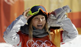 """In this Tuesday, Feb. 13, 2018 file photo, ChloeKim, of the United States, smiles during the women's halfpipe finals at Phoenix Snow Park at the 2018 Winter Olympics in Pyeongchang, South Korea. A San Francisco Bay Area radio station has fired one of its hosts, Patrick Connor, after he made sexual comments about 17-year-old Olympic snowboarder Kim on another station. Program director Jeremiah Crowe of KNBR-AM, where Connor hosted """"The Shower Hour,"""" confirmed the firing Wednesday, Feb. 14, 2018, for NBC Bay Area. (AP Photo/Lee Jin-man, File)"""