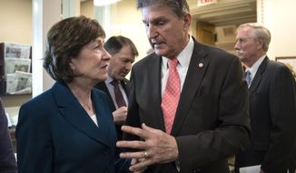 "Sen. Susan Collins, R-Maine, left, and Sen. Joe Manchin, D-W.Va., joined at rear by Sen. Mike Rounds, R-S.D., center, and Sen. Angus King, I-Maine, right, confer before a news conference on the bipartisan immigration deal they reached during a news conference at the Capitol in Washington, Thursday, Feb. 15, 2018. The Trump administration is already denouncing their deal in the Senate, saying it will ""create a mass amnesty for over 10 million illegal aliens, including criminals.""  (AP Photo/J. Scott Applewhite)"