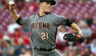 FILE - In this July 19, 2017, file photo, Arizona Diamondbacks starting pitcher Zack Greinke throws in the second inning of a baseball game against the Cincinnati Reds in Cincinnati. After an All-Star season but scuffling in the playoffs, Greinke is back for his third season with the Diamondbacks. (AP Photo/John Minchillo, File)