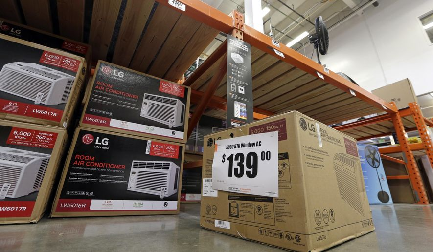 In this Aug. 1, 2017, file photo, fans and air conditioners are seen for sale at a hardware store in Seattle. (AP Photo/Elaine Thompson, File)