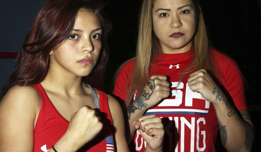 ADVANCE FOR USE SUNDAY, FEB. 18 AND THEREAFTER  Kayla Gomez, left, and her mother, Crystal Aceves, have amassed an impressive collection of title belts. (Rudy Gutierrez/El Paso Times via AP)