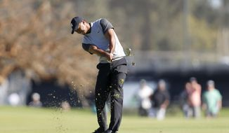Tiger Woods hits his second shot on the third hole during the first round of the Genesis Open golf tournament at Riviera Country Club Thursday, Feb. 15, 2018, in the Pacific Palisades area of Los Angeles. (AP Photo/Ryan Kang)